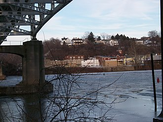 Belle Vernon, Pennsylvania - Belle Vernon, as seen from across the Monongahela River in a view showing the underside of the I-70 bridge looking ENE from Speers, PA