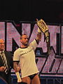 CM Punk stealing The Rock's WWE Championship.jpg