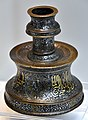 Candlestick with a hunting frieze and Persian verses. Engraved and inlaid decoration. From Iran. 13th century CE. Islamic Art Museum (Museum für Islamische Kunst), Berlin, Germany.jpg