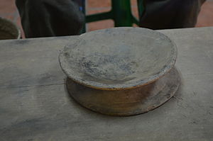 "Mexican ceramics - Example of a ""proto"" potters wheel at the Carlomagno Pedro Martinez workshop in San Bartolo Coyotepec, Oaxaca"