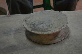 "Mexican ceramics - Example of a ""proto"" potters wheel at the Carlomagno Pedro Martinez workshop in San Bartolo Coyotepec, Oaxaca"