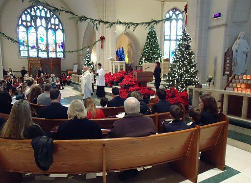 Catholics taking communion during mass at St Teresas church in Summit NJ