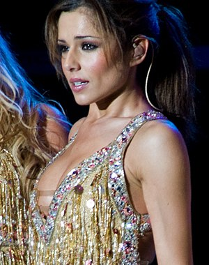 Cheryl Cole wearing a Lurex dress whilst perfo...
