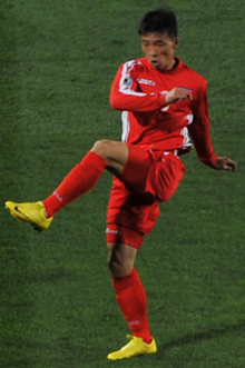 Chi Jun Nam, North Korean soccer player at FIFA 2010 World Cup vs. Brasil team. 15 June 2010.png