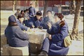 Chinese people having lunch outdoors - NARA - 194422.tif