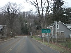 Signage entering Cold Brook via Herkimer County Route 224, approaching New York State Route 8.