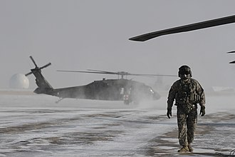 Colorado Army National Guard - A Colorado Army National Guard crew chief conducts preflight checks on a UH-60 Black Hawk helicopter during a blizzard response exercise.