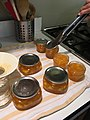 Covering clean, wiped jars with lids.jpg