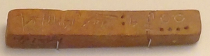 Cretan hieroglyphs - Cretan hieroglyphs (1900-1600 BC) on a clay bar from Malia or Knossos, Crete. As exhibited at Heraklion Archaeological Museum, Crete, Greece. Dots represent numerals