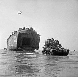Cromwell pursuit tank with men aboard.jpg