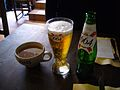 Cup of cider and bottle and glass of beer.jpg