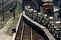 DA-ST-87-13022 Military vehicles crowd railroad flatcars in the train station after participating in the joint US South Korean Exercise TEAM SPIRIT '87.jpeg