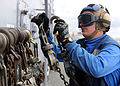Defense.gov News Photo 100913-N-5538K-213 - U.S. Navy Airman Recruit Jeremy J. New stows tie-down chains after removing them from a CH-46E Sea Knight helicopter aboard the USS Essex LHD 2 in.jpg