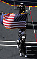 Defense.gov News Photo 110801-N-XM900-206 - Members of the color guard aboard the aircraft carrier USS John C. Stennis CVN 74 parade the colors during a burial at sea while underway in the.jpg