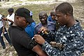 Defense.gov News Photo 110802-N-XK513-063 - U.S. Navy Petty Officer 2nd Class Eseosa Osemwota right instructs a group of Nigerian service members on the proper application of a tourniquet.jpg
