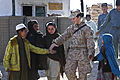 Defense.gov News Photo 120120-M-7721G-014 - U.S. Navy Petty Officer 2nd Class Kimberley Ryan holds hands with Afghan children as they walk to the local children s shura near Forward Operating.jpg