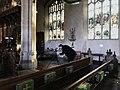 Director and writer Simon Nunn filming medieval graffiti.jpg