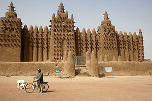Great Mosque of Djenné - The Great Mosque's signature trio of minarets overlooks the central market of Djenné.