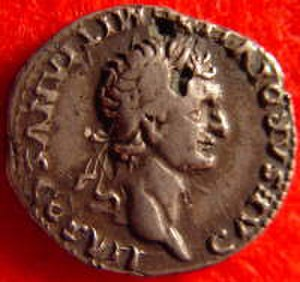 Counterfeit money - Plated counterfeit of the Roman emperor Domitian. By using a copper core covered in a silver coating, the coin has a much lower intrinsic value, while face value remains the same.