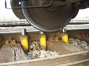 "Rail yard - Smaller local hydraulic ""Dowty retarders"" finesse the speed of a car being sorted as it approaches a switch or the new consists to which it is being joined."