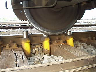 """Rail yard - Smaller local hydraulic """"Dowty retarders"""" finesse the speed of a car being sorted as it approaches a switch or the new consists to which it is being joined."""