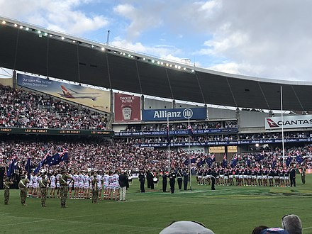 Pre-match formalities taking place prior to the Dragons vs Roosters Anzac Day clash in 2018. Dragons vs Roosters, Anzac Day 2018.jpg