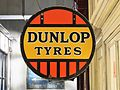 Dunlop Tyres enamel advertising sign at de Louwman museum.JPG