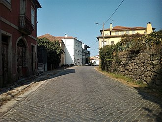 Roads in Portugal - Section of the N 16 in Oliveira de Frades paved in granite blocks which was typical of the original national roads in Portugal.