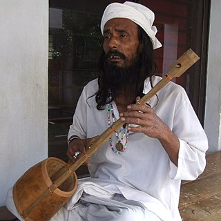 A Baul from Lalon Shah's shrine in Kushtia Ektara player.jpg