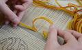 Exemple de nœud avec aiguille courbe.png