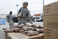 FEMA - 38316 - Soldier picks up MREs to distribut to Texas residents at a POD site.jpg