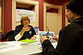 FEMA - 39908 - Applicant speaks with a FEMA representative at a center in Washington.jpg