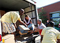 FEMA - 44157 - Volunteers unload a truck with supplies.jpg
