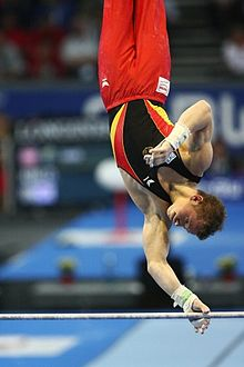 Gymnastique artistique masculine wikip dia for Barre fixe enfant