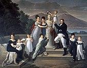 Das Gemälde von Giuseppe Cammarano zeigt von links nach rechts Maria Isabella von Bourbon-Spanien (zweite Frau von Franz I.) mit Maria Carolina und Maria Antonietta, die zukünftige Großherzogin der Toskana. Luisa Carlotta umarmt die zukünftige Königin von Spanien, Maria Cristina. Am Sockel der Büste Ferdinand I., der kleine Ferdinand II., Erbe des Königreichs beider Sizilien. Franz I. trägt Maria Amalia in Händen, rechts: Carlo, Prinz von Capua und Leopoldo, Graf von Syrakus (Quelle: Wikimedia)