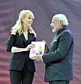 Famous singer, Valeriya who was the brand ambassador for IDY in Russia, presents her book on Yoga to the Prime Minister, Shri Narendra Modi, in Moscow, Russia on December 24, 2015.jpg