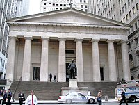 Neoclassical building with doric columns and a statue of George Washington