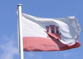 Flag of Gibraltar - Flag of Gibraltar atop the Rock of Gibraltar