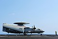 Flickr - Official U.S. Navy Imagery - A Sailor directs an E-2C Hawkeye on the flight deck of USS George H.W. Bush..jpg
