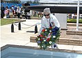 Flickr - Official U.S. Navy Imagery - Claudia Richie lays a wreath in a pool of water during a Memorial Day ceremony at the World War II National Submarine Memorial-West..jpg