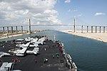 Flight deck of USS George H.W. Bush (CVN-77) and Suez Canal Bridge during transit (141027-N-MW819-192).jpg