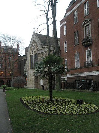 Church of the Immaculate Conception, Farm Street - Mount Street Gardens view of the church. The Mount Street centre is on the left.