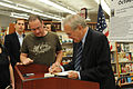 "Former U.S. Secretary of Defense Donald Rumsfeld, right, signs his autobiography, ""Known and Unknown- A Memoir,"" at the Commander Fleet Activities Yokosuka, Japan, Navy Exchange Oct 111008-N-IO627-042.jpg"