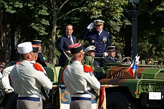 Bastille Day military parade - François Hollande, President of the French Republic, and Admiral Édouard Guillaud, Chief of the Defence Staff reviewing the troops in an ACMAT command car.