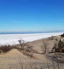 Overlooking A Frozen Lake Michigan And The Indiana Dunes State Park Pavilion