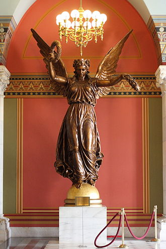 Connecticut State Capitol - The Genius of Connecticut by sculptor Randolph Rogers (1877–78), a plaster version of the bronze statue (destroyed) originally mounted on top of the dome, is exhibited on the main floor.