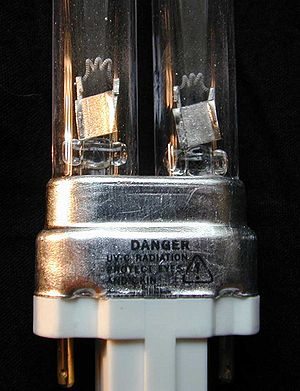 Germicidal lamp - Close-up of the electrodes and the safety warning