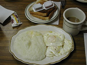 English: A southern breakfast of grits, toast ...