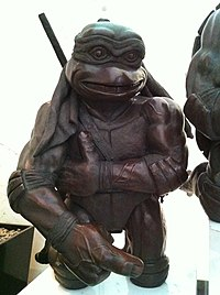 HK TST 100 Canton Road The ToyHouse lift lobby exhibits Playmates Toys 隱者龜 Turtles bronze sculpture big hand Dec-2012.JPG