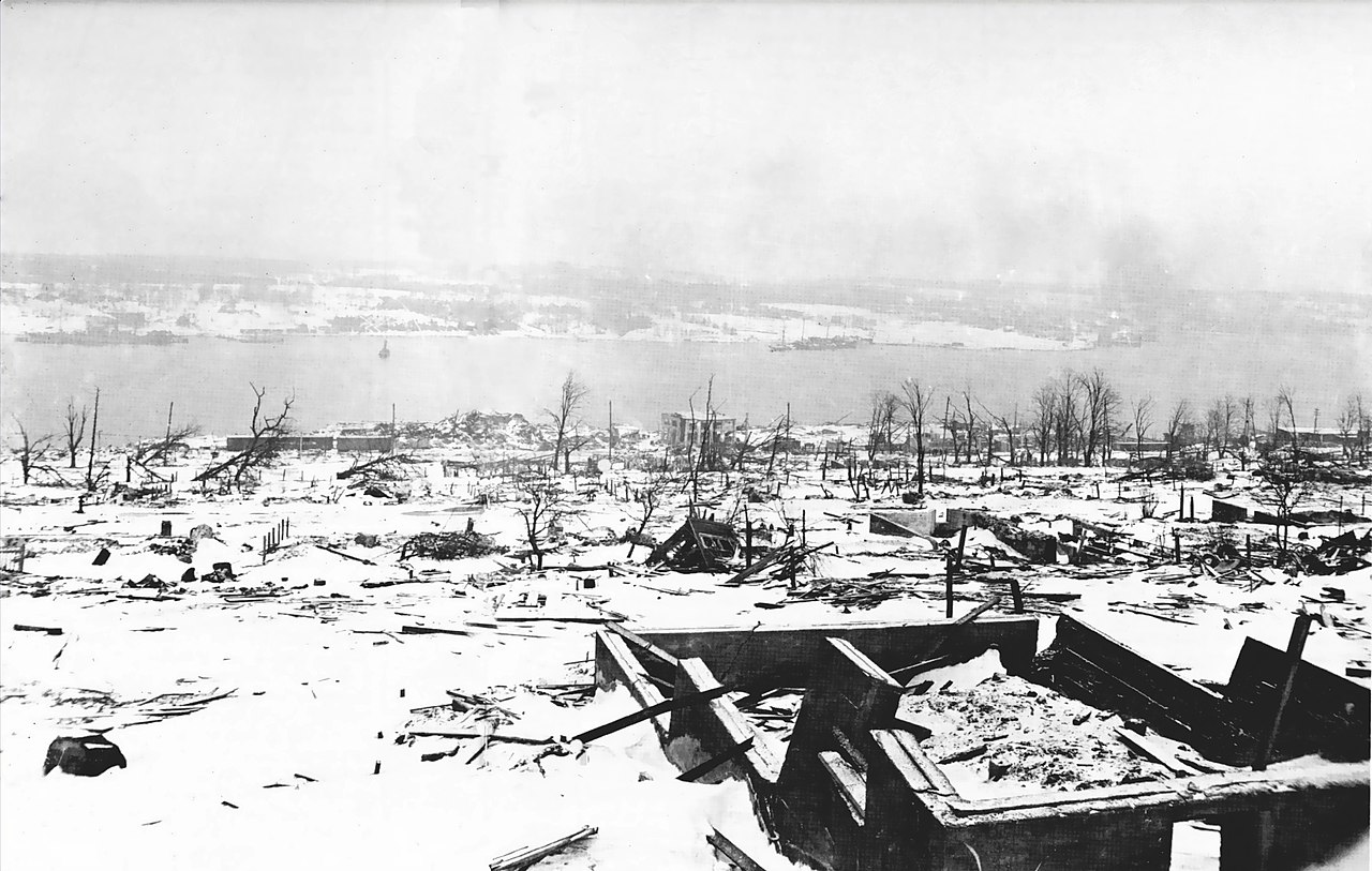 Destroyed buildings, with harbour in background